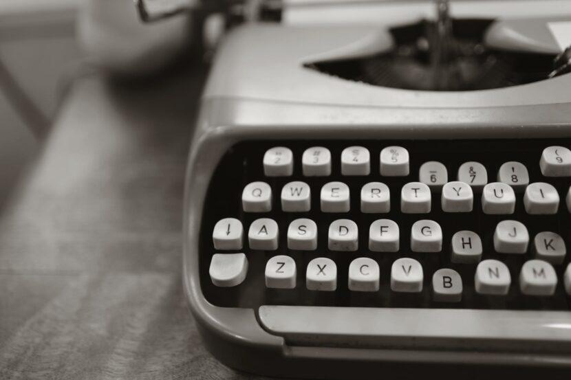 close up photo of gray typewriter